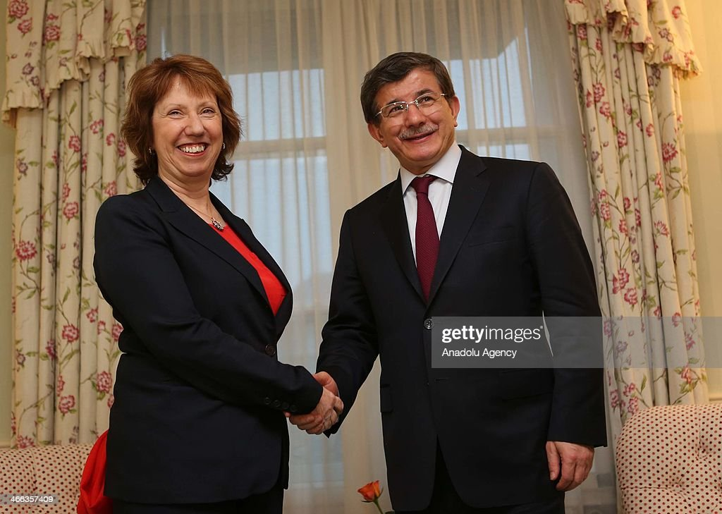 Turkey's Foreign Minister Ahmet Davutoglu (R) shakes hand European Union High Representative for Foreign Affairs and Security Policy Catherine Ashton (L) at the 50th Munich Security Conference to be held between 31st January and 2nd February at the Bayerischer Hof hotel on February 1, 2014 in Munich, Germany.