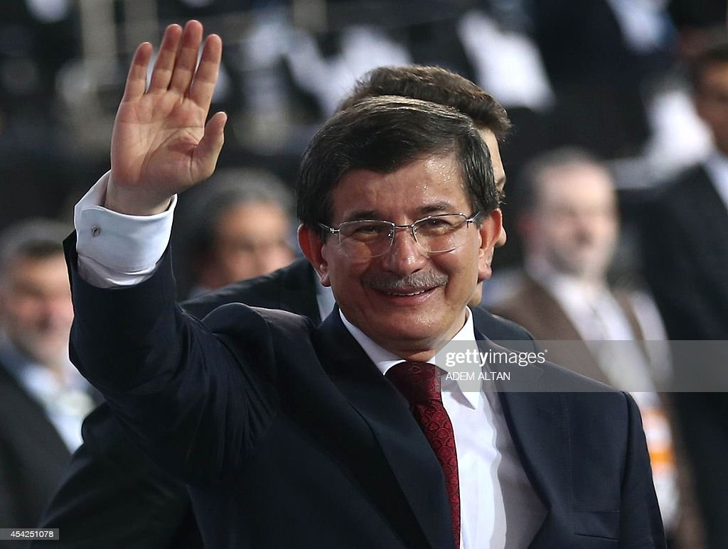 Turkey's Foreign Minister Ahmet Davutoglu waves during the Extraordinary Congress of the ruling Justice and Development Party (AKP) in Ankara on August 27, 2014. Davutoglu was approved by the ruling Justice and Development Party (AKP) as its new leader and prime minister to take over when Recep Tayyip Erdogan moves to the presidency on August 28, 2014.