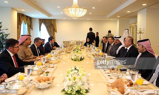 Turkey's Foreign Minister Mevlut Cavusoglu and his Qatari counterpart Khalid bin Mohammad Al Attiyah are seen during lunch at the Foreign Ministry in...