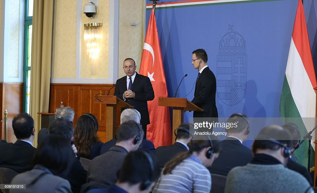 Turkey's Foreign Minister Mevlut Cavusoglu (L) and Hungary's Foreign Minister Peter Szijjarto (R) hold joint press conference after their meeting in Budapest, Hungary on February 9, 2016.