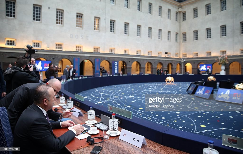 Turkey's Foreign Minister Mevlut Cavusoglu (L) attends Informal Gymnich meeting of EU foreign ministers in Amsterdam, Netherlands on February 6, 2016.