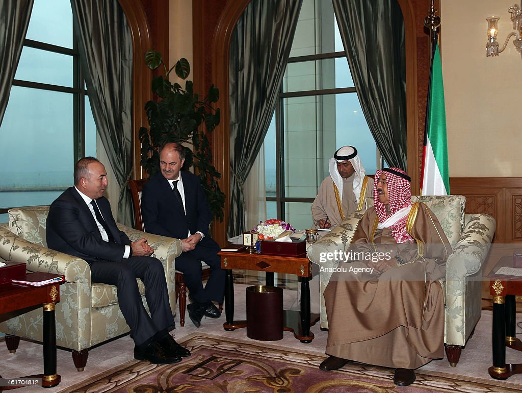 Turkey's Foreign Minister Mevlut Cavusoglu (L) meets Emir of Kuwait <a gi-track='captionPersonalityLinkClicked' href=/galleries/search?phrase=Sabah+Al-Ahmad+Al-Jaber+Al-Sabah&family=editorial&specificpeople=5573991 ng-click='$event.stopPropagation()'>Sabah Al-Ahmad Al-Jaber Al-Sabah</a> (R) during his official visit in Kuwait City, Kuwait on January 18, 2015.
