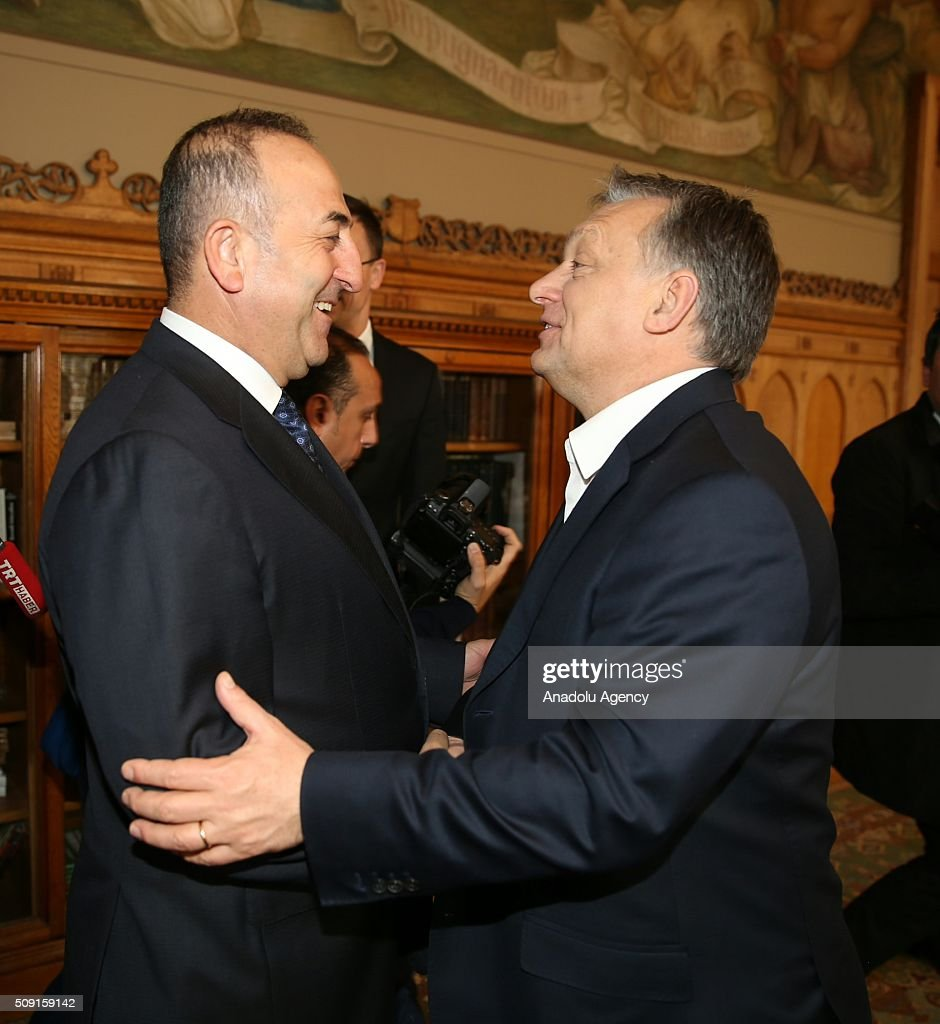 Turkey's Foreign Minister Mevlut Cavusoglu (L) meets Hungarian Prime Minister Viktor Orban (R) in Budapest, Hungary on February 9, 2016.