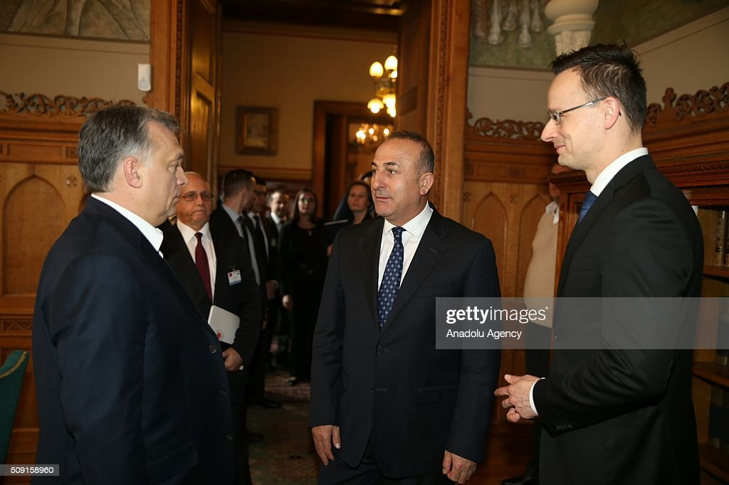 Turkey's Foreign Minister Mevlut Cavusoglu (C) meets Hungarian Prime Minister Viktor Orban (L) and Hungarian Foreign Minister Petro Szijjarto (R) in Budapest, Hungary on February 9, 2016.