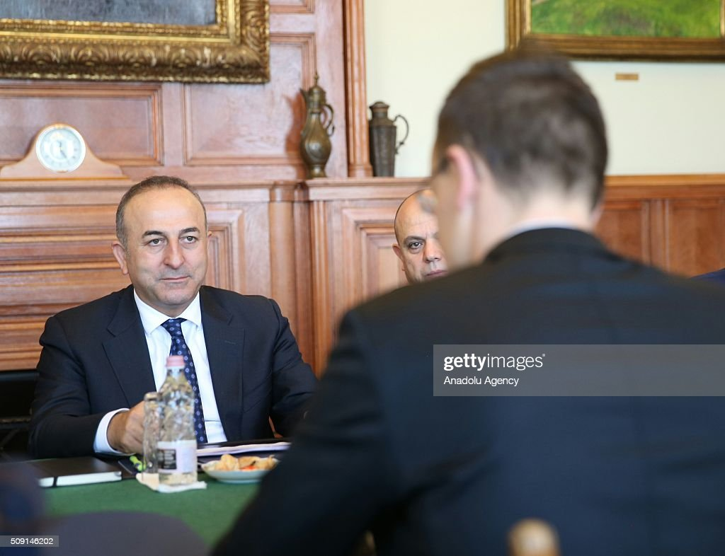 Turkey's Foreign Minister Mevlut Cavusoglu (L) meets Hungary's Foreign Minister Peter Szijjarto (R) in Budapest, Hungary on February 9, 2016.
