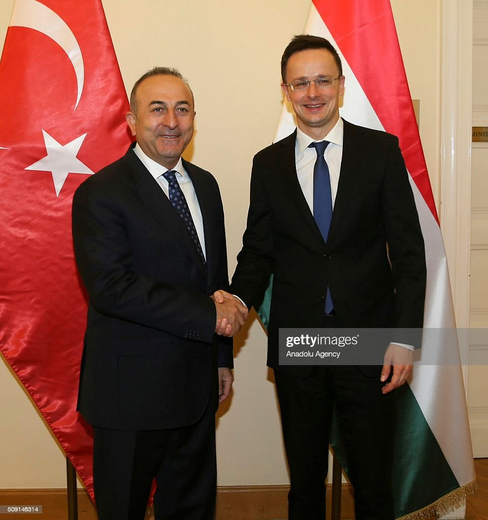 Turkey's Foreign Minister Mevlut Cavusoglu (L) shakes hands with Hungary's Foreign Minister Peter Szijjarto (R) at the end of their meeting in Budapest, Hungary on February 9, 2016.