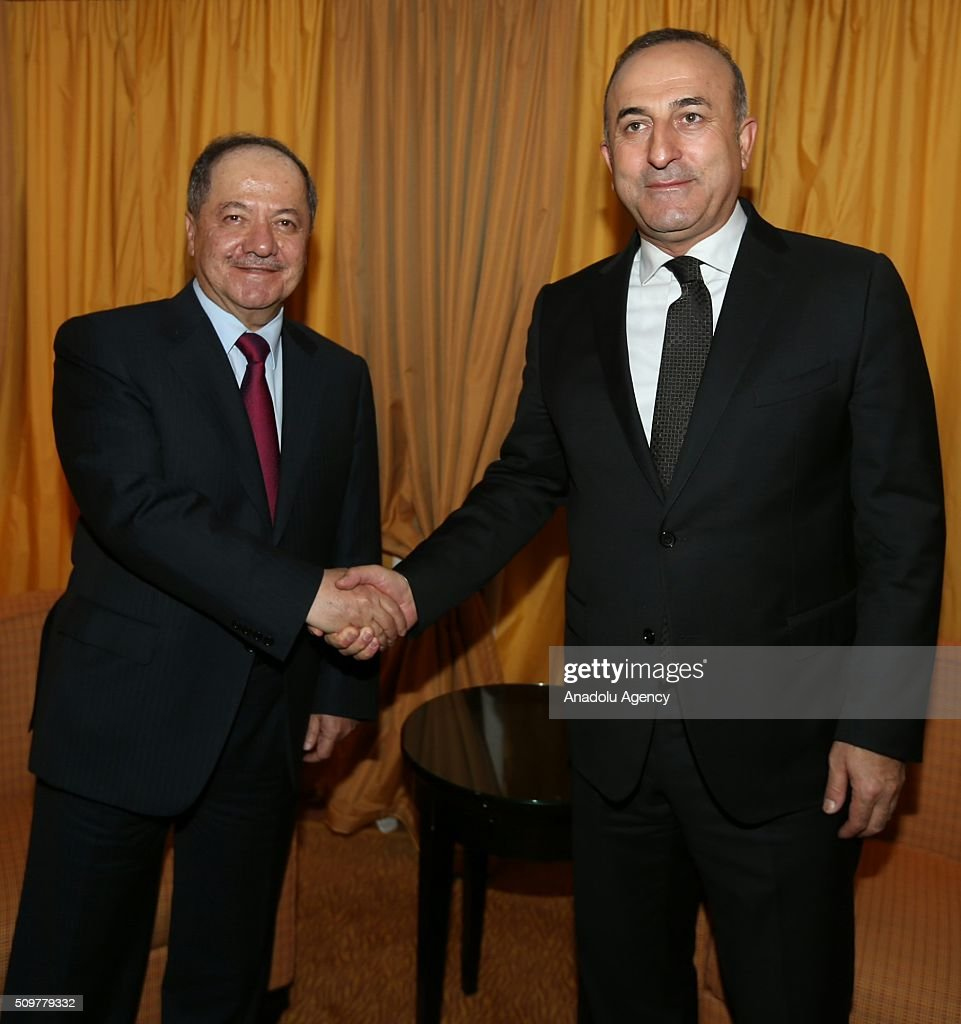Turkey's Foreign Minister Mevlut Cavusoglu (R) shakes hands with Iraqi Kurdish Regional Government's (IKRG) President Masoud Barzani (L) as the 52nd Munich Security Conference continues in Munich, Germany on February 12, 2016.