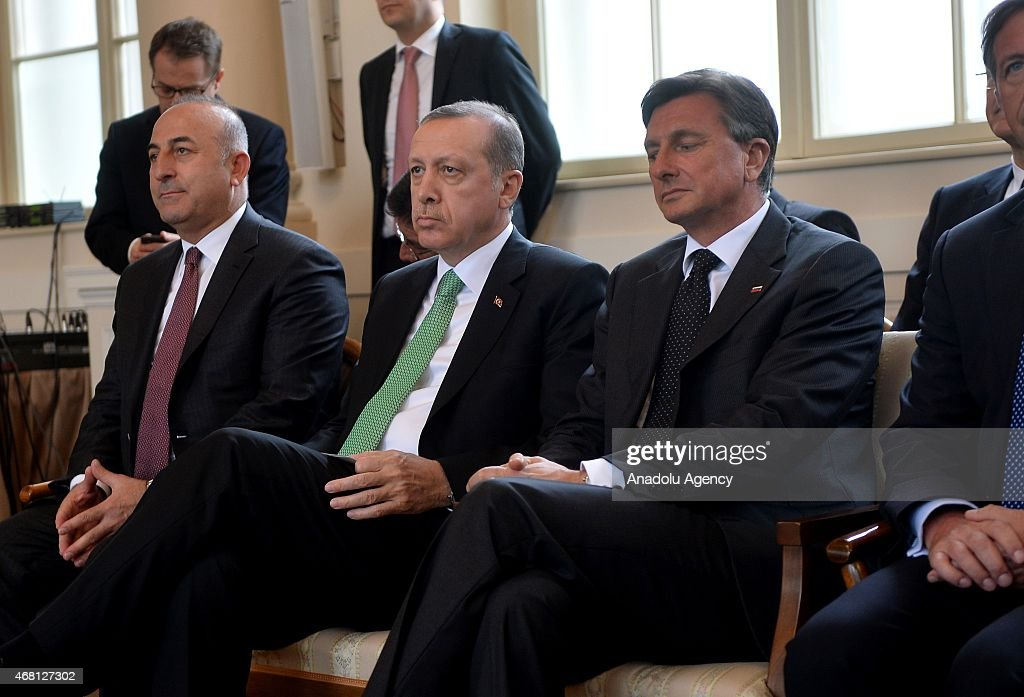 Turkey's Foreign Minister Mevlut Cavusoglu (L), Turkey's President <a gi-track='captionPersonalityLinkClicked' href=/galleries/search?phrase=Recep+Tayyip+Erdogan&family=editorial&specificpeople=213890 ng-click='$event.stopPropagation()'>Recep Tayyip Erdogan</a> (2nd L) and <a gi-track='captionPersonalityLinkClicked' href=/galleries/search?phrase=Borut+Pahor&family=editorial&specificpeople=2476171 ng-click='$event.stopPropagation()'>Borut Pahor</a> (R), President of the Republic of Slovenia, attend a joint press conference after their meeting at the presidential palace in Ljubljana on March 30, 2015.