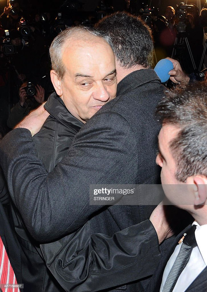 Turkey's former army chief Ilker Basbug (L) hugs a relative after being released from prison on March 7, 2014 at Silivri, in Istanbul. Basbug who was jailed for life last year for plotting to overthrow the Islamic-rooted government walked free from the prison on March 7 after a Turkish court ordered his release. The ruling came a day after Turkey's top Constitutional Court ruled that Basbug's legal rights had been violated, saying that a lower court had failed to publish its detailed verdict on the case and send it to the appeals court. AFP PHOTO / STRINGER