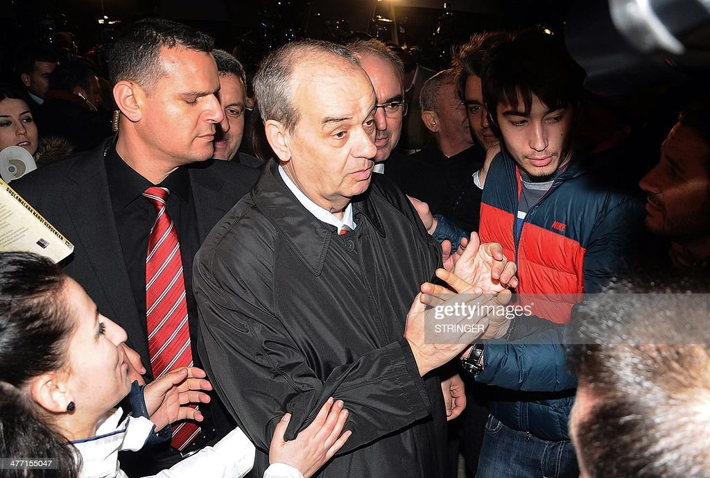 Turkey's former army chief Ilker Basbug (C) shakes hands with supporters after being released from prison on March 7, 2014 at Silivri, in Istanbul. Basbug who was jailed for life last year for plotting to overthrow the Islamic-rooted government walked free from the prison on March 7 after a Turkish court ordered his release. The ruling came a day after Turkey's top Constitutional Court ruled that Basbug's legal rights had been violated, saying that a lower court had failed to publish its detailed verdict on the case and send it to the appeals court.