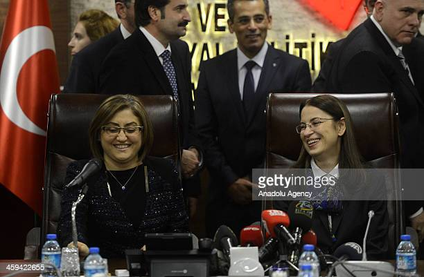 Turkey's former Family and Social Policies Minister Fatma Sahin hands over her office to the newlyappointed minister Aysenur Islam during a handover...
