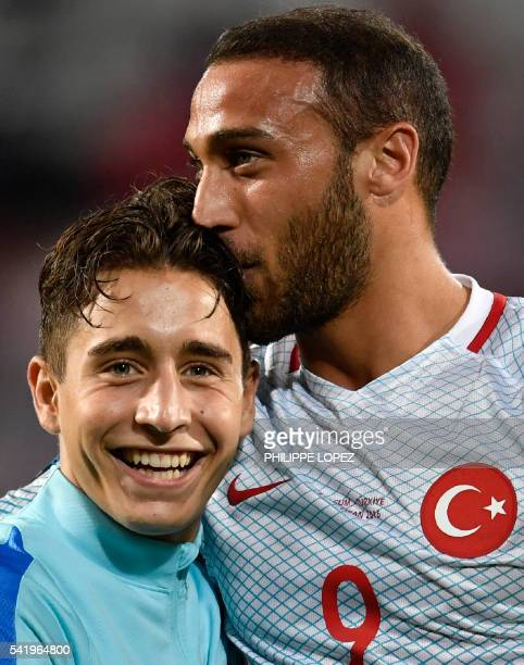 Turkey's forward Emre Mor and Turkey's forward Cenk Tosun celebrate their team's victory at the end of the Euro 2016 group D football match between...