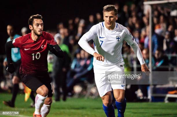 Turkey's Hakan Calhanoglu and Finland's Robin Lod during the FIFA World Cup 2018 qualification football match between Finland and Turkey in Turku...