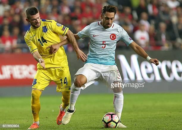 Turkey's Hakan Calhanoglu vies with Kosovo's Valon Berisha during the 2018 World Cup group I qualifying football match between Turkey and Kosovo in...