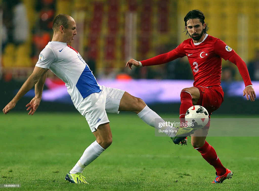 Turkey's Hasan Ali Kaldirim challanges with <a gi-track='captionPersonalityLinkClicked' href=/galleries/search?phrase=Arjen+Robben&family=editorial&specificpeople=194740 ng-click='$event.stopPropagation()'>Arjen Robben</a> of Netherlands during FIFA 2014 World Cup Qualifier match at the Sukru Saracoglu Stadium on October 15, 2013 in Istanbul, Turkey.