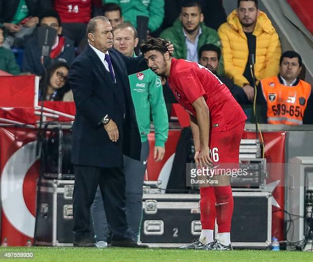 Turkey's head coach Fatih Terim gestures Turkey's Ozan Tufan during an international friendly soccer match between Greece and Turkey November 17 2015...
