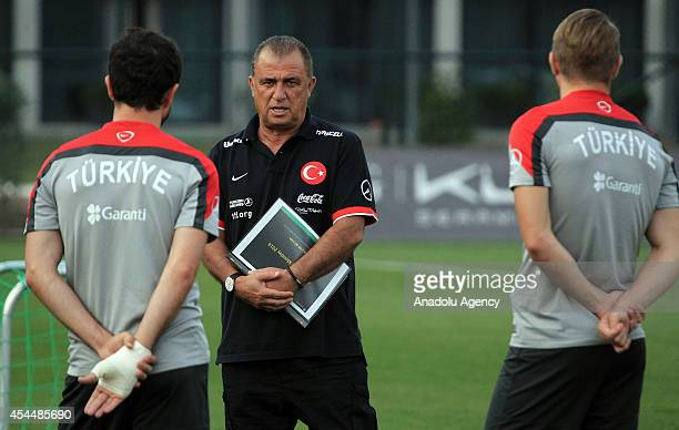 Turkey's head coach Fatih Terim leads a training session ahead of a friendly game against Denmark in Istanbul Turkey on September 1 2014 Turkey will...