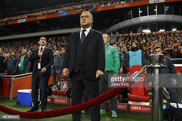 Turkey's head coach Fatih Terim looks on as the national anthems are played during the Euro 2016 qualifying round football match Netherlands and...