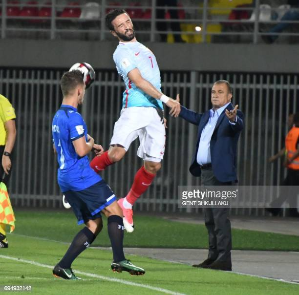 Turkey's head coach Fatih Terim react as Kosovo's Donis Avdijaj vies with Turkey's Gokhan Gonul during the FIFA World Cup 2018 qualification football...
