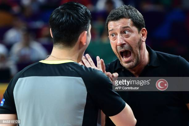 Turkey's head coach Ufuk Sarica argues with referee during the FIBA Eurobasket 2017 men's round 16 basketball match between Spain and Turkey at Sinan...
