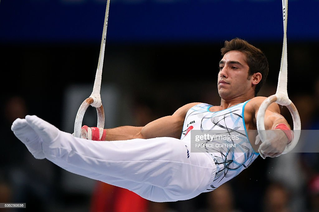 Turkeys Ibrahim Colak performs during the Mens Rings competition of the European Artistic Gymnastics Championships 2016 in Bern, Switzerland on May 29, 2016. / AFP / FABRICE