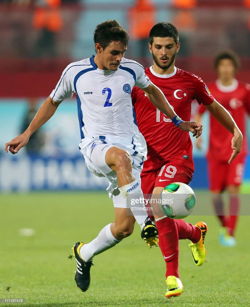 Turkey's Ibrahim Yilmaz (R) vies for the ball with El Salvador's Olivier Ayala (L) during the group stage football match between Turkey and El Salvador at the FIFA Under 20 World Cup at the Avni Aker stadium in Trabzon on June 22, 2013.