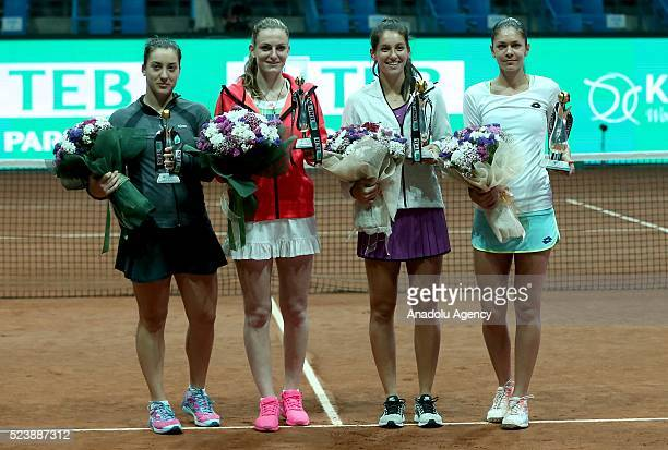 Turkey's Ipek Soylu and Romania's Andreea Muti hold their winning cups after the TEB BNP Paribas stanbul Cup in Istanbul Turkey on April 24 2016...