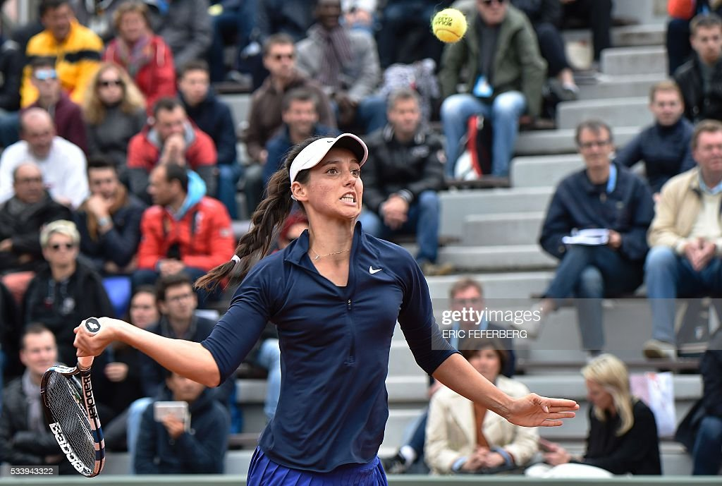 Turkey's Ipek Soylu returns the ball to France's Virginie Razzano during their women's first round match at the Roland Garros 2016 French Tennis Open in Paris on May 24, 2016. / AFP / Eric FEFERBERG