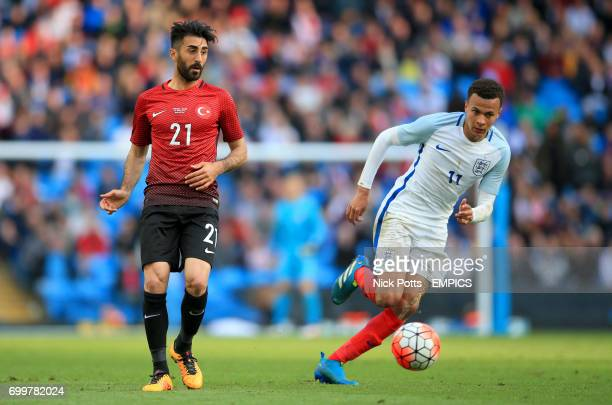 Turkey's Mahmut Tekdemir makes his pass as he is challenged by England's Dele Alli