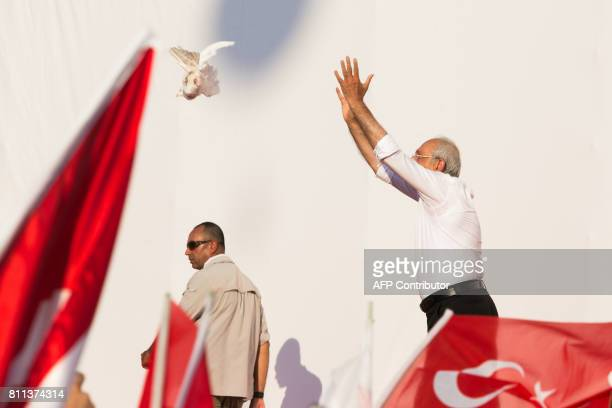 TOPSHOT Turkey's main opposition Republican People's Party leader Kemal Kilicdaroglu releases a dove during a rally in Istanbul on July 9 marking the...