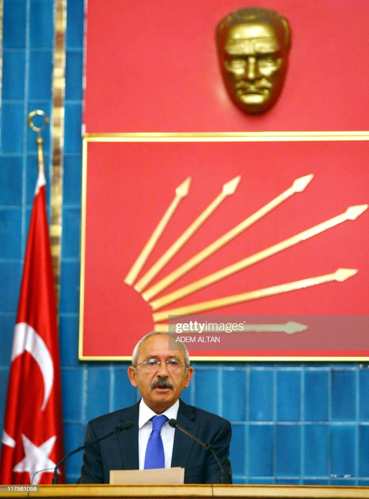 Turkey's main opposition Republican People's Party (CHP) leader Kemal Kilicdaroglu addresses the media at the Turkish Parliament in Ankara on June 28, 2011. Turkey's new parliament opened in a tense atmosphere as the main opposition and Kurdish deputies boycotted the ceremony in protest over lawmakers kept in prison.Shortly before parliament convened for oath-taking, the centre-left Republican People's Party (CHP) announced its members would shun the ceremony, following a boycott announced by Kurdish-backed lawmakers last week.