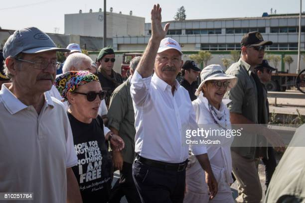 Turkey's main opposition Republican People's Party leader Kemal Kilicdaroglu waves to the crowd leads thousands of supporters on day 23 of the...