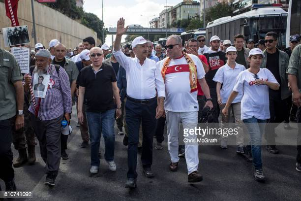 Turkey's main opposition Republican People's Party leader Kemal Kilicdaroglu waves to the crowd as he leads thousands of supporters on day 24 of the...
