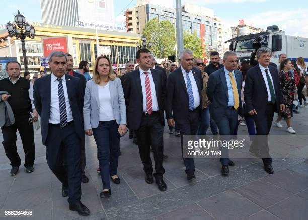 Turkey's main opposition Republican People's Party MPs walk together during a protest against the arrest of former primary school teacher Semih...