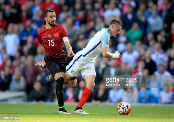 Turkey's Mehmet Topal tackles England's Jamie Vardy which results in a penalty for England