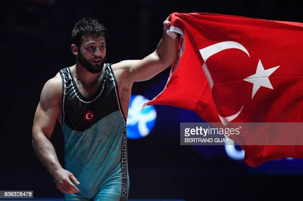 TOPSHOT Turkey's Metehan Basar celebrates after winning the men's GrecoRoman style 85 kg category final of the FILA World Wrestling Championships in...