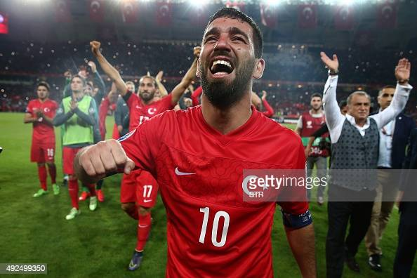 Turkey's midfielder Arda Turan celebrates at the end of the Euro 2016 Group A qualifying football match between Turkey and Iceland on October 13 2015...