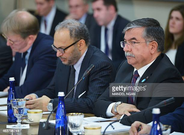Turkey's Minister of National Defense Ismet Yilmaz and United Arab Emirates Minister of State for Foreign Affairs Anwar Gargash take part in the...