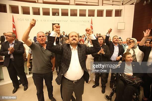 Turkey's MP's react to the attacks through the night at the Turkish parliament July 16 2016 in Ankara Turkey Istanbul's bridges across the Bosphorus...