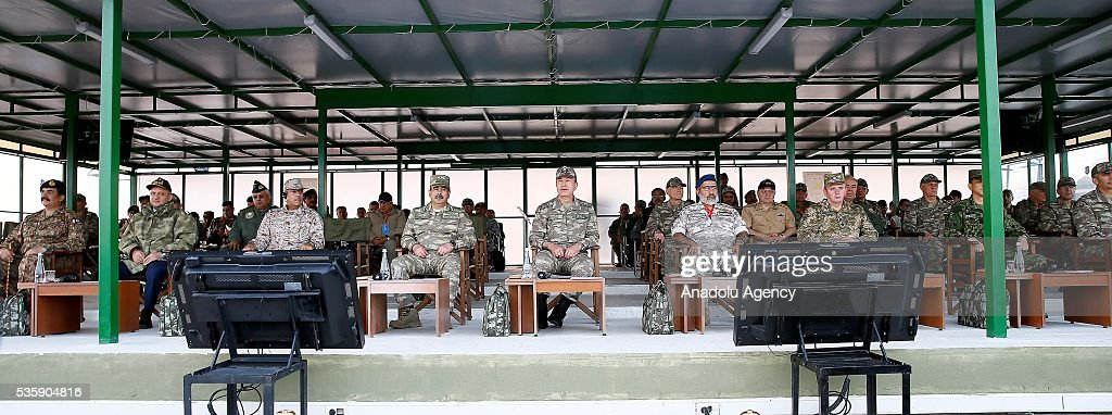 Turkey's National Defense Minister Fikri Isik (L-2), Chief of the General Staff of the Turkish Armed Forces, Hulusi Akar (C) and other commanders are seen during the Efes-2016 Combined Joint Live Fire Exercise at Seferihisar district of Izmir, Turkey on May 30, 2016. The Turkish-led multinational military exercises, Efes-2016 which started at 04 May and will be finished at 04 June 2016, aims to train participating units and staff in planning and conducting combined and joint operations, including logistics and command-control as well as to improve the level of interoperability among headquarters and forces.