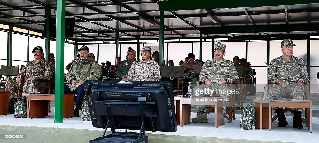 Turkey's National Defense Minister Fikri Isik (L-2), Chief of the General Staff of the Turkish Armed Forces, Hulusi Akar (R) and other commanders are seen during the Efes-2016 Combined Joint Live Fire Exercise at Seferihisar district of Izmir, Turkey on May 30, 2016. The Turkish-led multinational military exercises, Efes-2016 which started at 04 May and will be finished at 04 June 2016, aims to train participating units and staff in planning and conducting combined and joint operations, including logistics and command-control as well as to improve the level of interoperability among headquarters and forces.