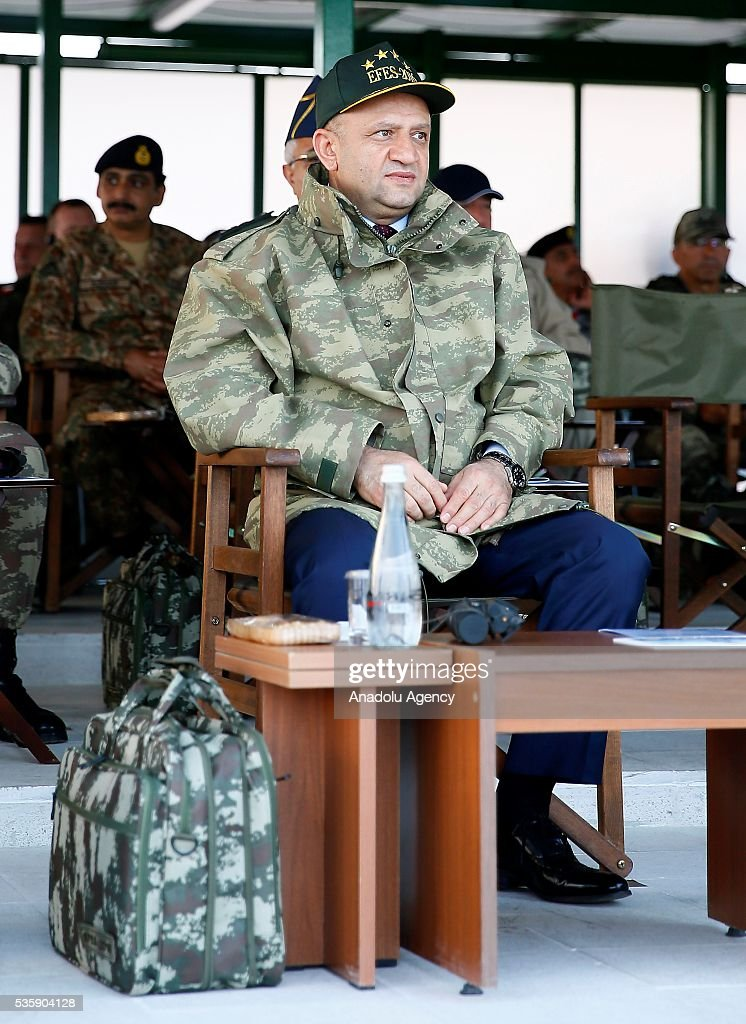 Turkey's National Defense Minister Fikri Isik is seen during the Efes-2016 Combined Joint Live Fire Exercise at Seferihisar district of Izmir, Turkey on May 30, 2016. The Turkish-led multinational military exercises, Efes-2016 which started at 04 May and will be finished at 04 June 2016, aims to train participating units and staff in planning and conducting combined and joint operations, including logistics and command-control as well as to improve the level of interoperability among headquarters and forces.