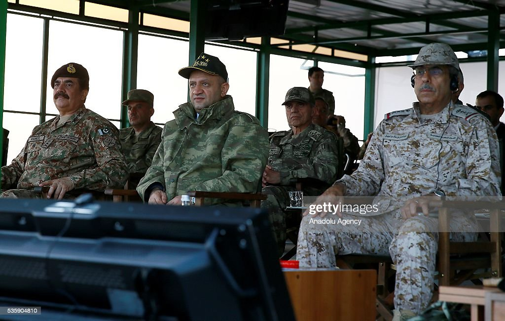 Turkey's National Defense Minister Fikri Isik (C) is seen during the Efes-2016 Combined Joint Live Fire Exercise at Seferihisar district of Izmir, Turkey on May 30, 2016. The Turkish-led multinational military exercises, Efes-2016 which started at 04 May and will be finished at 04 June 2016, aims to train participating units and staff in planning and conducting combined and joint operations, including logistics and command-control as well as to improve the level of interoperability among headquarters and forces.
