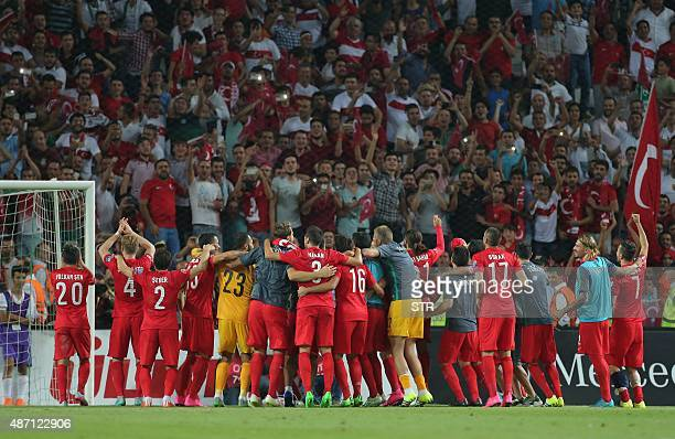 Turkey's national football team players acknowledge fans after defeating The Netherlands 30 in their Euro 2016 qualifying match at Konya's Arena on...