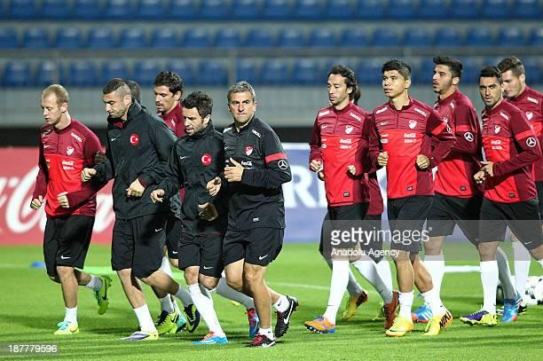 Turkey's national team players warm up during the team's training session at Kasimpasa Recep Tayyip Erdogan stadium on November 12 2013 in Istanbul...
