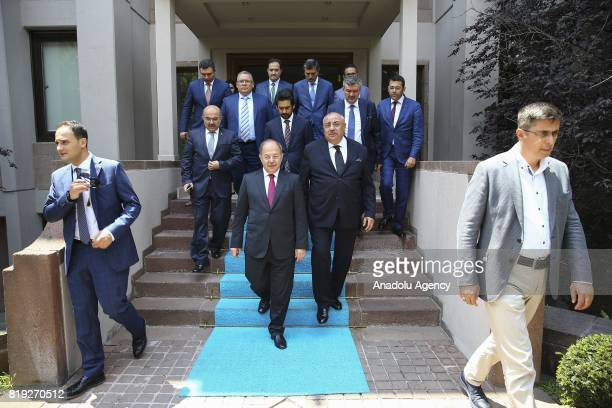 Turkey's new Deputy Prime Minister Recep Akdag and former Turkish Deputy Prime Minister Tugrul Turkes leave the Turkish Prime Ministry building after...
