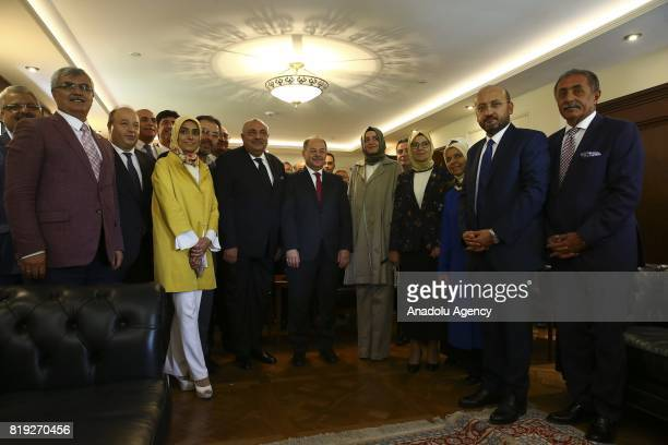 Turkey's new Deputy Prime Minister Recep Akdag former Turkish Deputy Prime Minister Tugrul Turkes and Turkish Minister of Family and Social Policies...