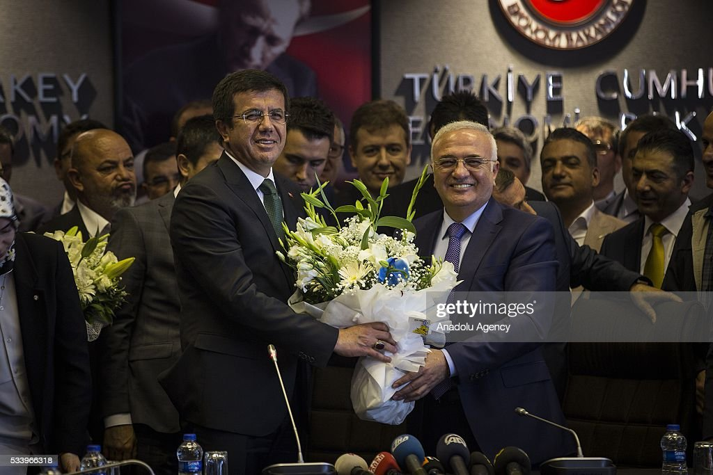 Turkey's new Economy Minister (L) Nihat Zeybekci meets with his predecessor for an inauguration ceremony at the ministry's building in Ankara, Turkey on May 24, 2016.