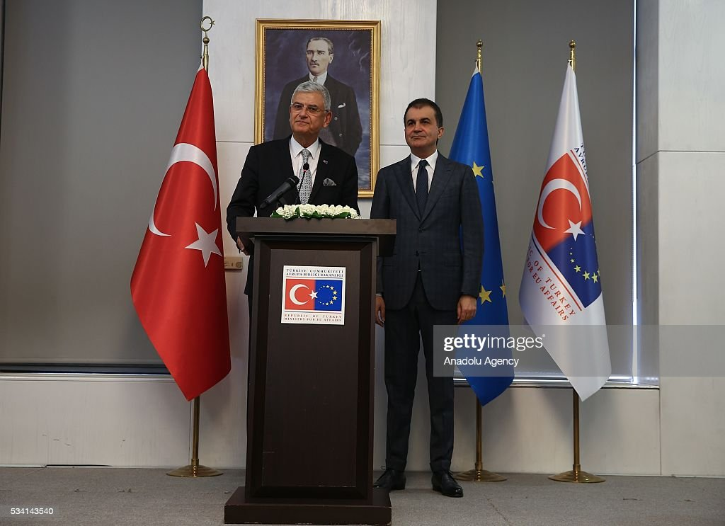 Turkey's new EU Affairs Minister and Chief Negotiator Omer Celik (R) and outgoing Turkish Minister for EU Affairs and Chief Negotiator of Turkey Volkan Bozkir (L) attend an inauguration ceremony in Ankara, Turkey on May 25, 2016.