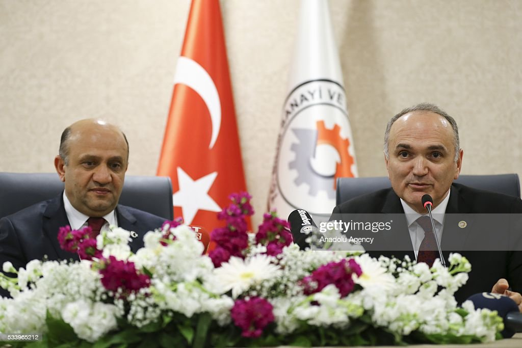 Turkey's new Minister of Science, Industry and Technology Faruk Ozlu (R) meets with outgoing Minisiter of Science, Industry and Technology Fikri Isik (L) for an inauguration ceremony at the ministry's building in Ankara, Turkey on May 24, 2016. Fikri Isik is appointed as the new Defense Minister of Turkey.